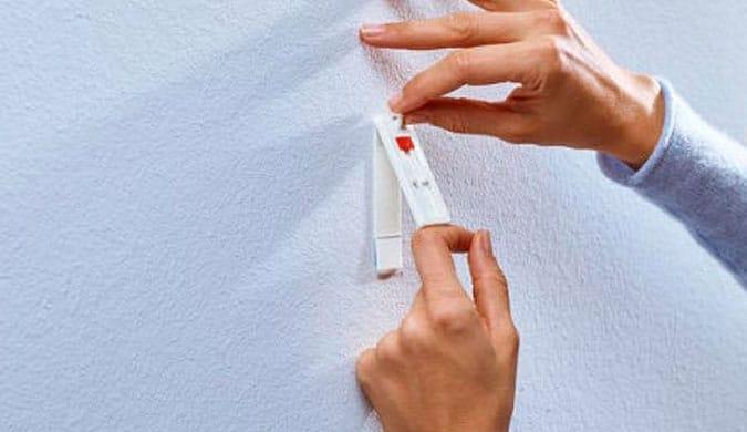 Cinta adhesiva para colgar cuadros de gran peso