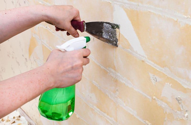 como pegar papel en pared de cemento